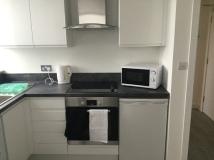 7. First flat kitchen 1